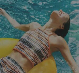 Custom Pool Design - woman on a pool float | Pool and Spa Superstore Inc.