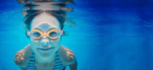 Girl swimming underwater with googles | Homepage hero | Pool and Spa Superstore Inc.