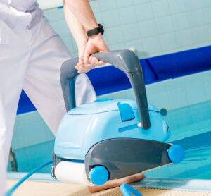 Man holding robotic pool cleaner - Pools and Equipment section | Pool and Spa Superstore Inc.