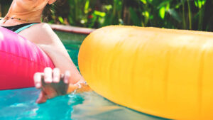 Woman enjoying the water in a swimming pool | Pool and Spa Superstore Inc.