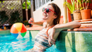 Pools Hero Image - woman in in-ground pool | Pool and Spa Superstore
