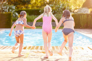 Kids running toward pool | Contact Us Hero | Pool and Spa Superstore Inc.
